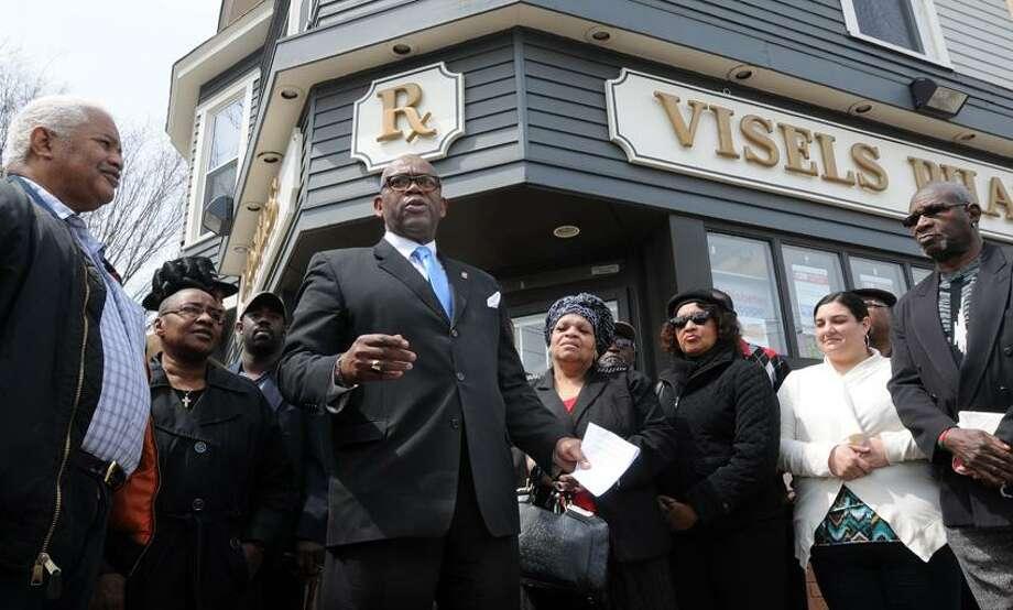 "Current New Haven City Clerk Ron Smith announces he will run again for the job, outside Visel's Pharmacy on Dixwell Ave. Mara Lavitt/New Haven Register <a href=""mailto:mlavitt@newhavenregister.com"">mlavitt@newhavenregister.com</a>4/15/13"
