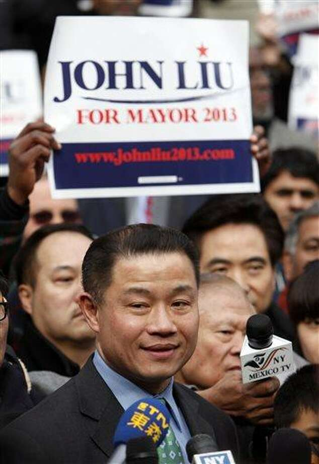FILE - New York City Comptroller John Liu announces the launch of his mayoral campaign on the steps of City Hall, in this March 17, 2013 file photo taken in New York. A jury is set to hear the conspiracy case against a former political campaign treasurer and a fundraiser for New York City mayoral hopeful John Liu (loo). Liu is currently New York City's comptroller. He hasn't been charged and has denied any wrongdoing as he runs for mayor. (AP Photo/Jason DeCrow, File) Photo: AP / FR103966 AP