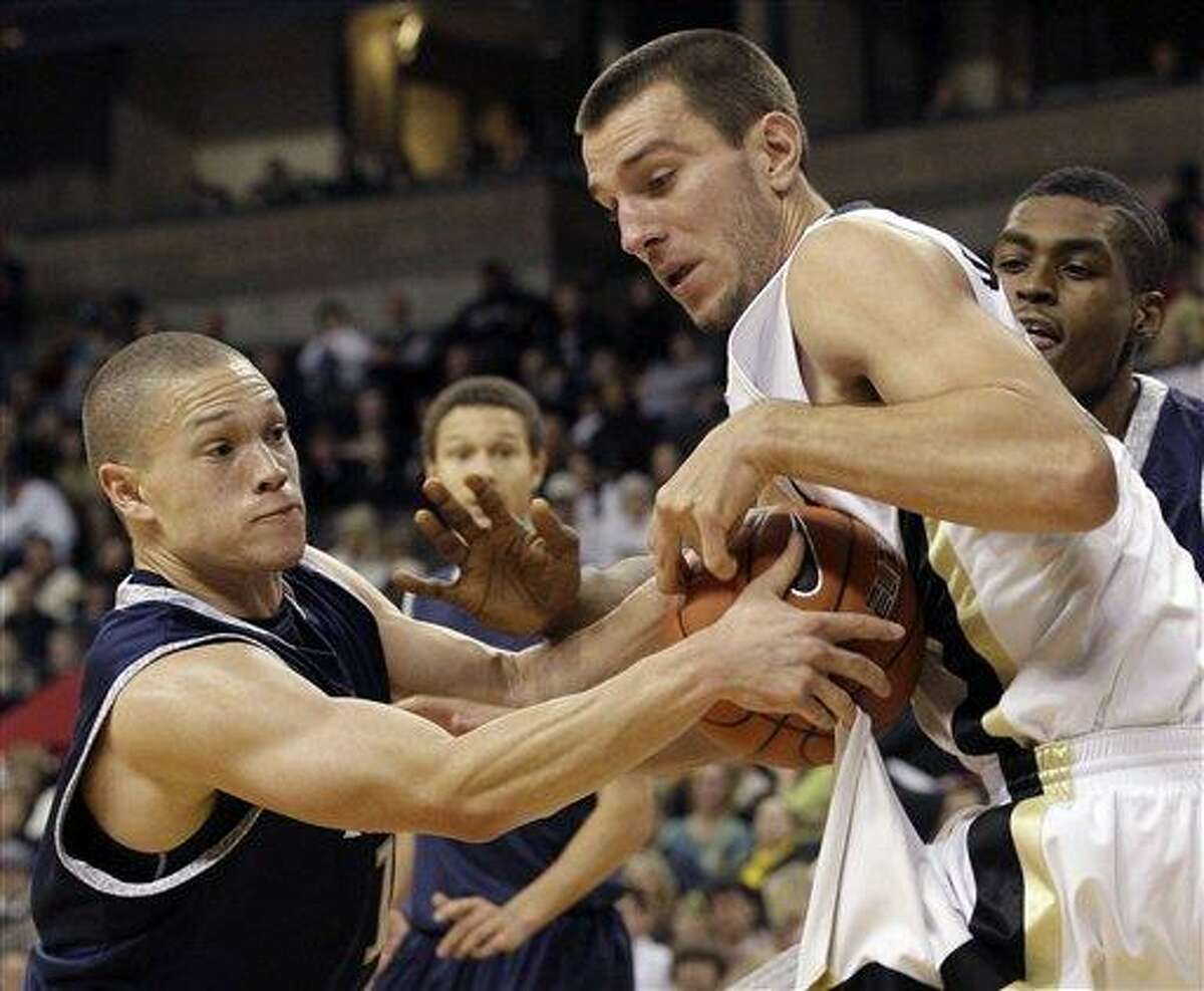 Yale's Austin Morgan, left, steals the ball from Wake Forest's Carson Desrosiers, right, during the second half of Wake Forest's 72-71 win in an NCAA college basketball game in Winston-Salem, N.C., Thursday, Dec. 29, 2011. (AP Photo/Chuck Burton)