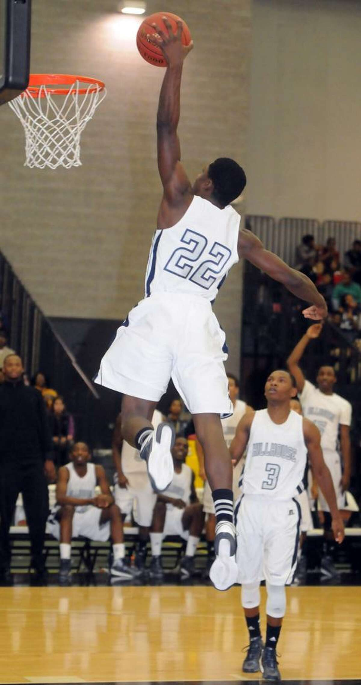 Hillhouse's Shane Christie goes up for the dunk agaimnst Career. Christie and the Academics face Fairfield Prep Tuesday night in a battle of SCC undefeated teams. Mara Lavitt/New Haven Register 12/17/12