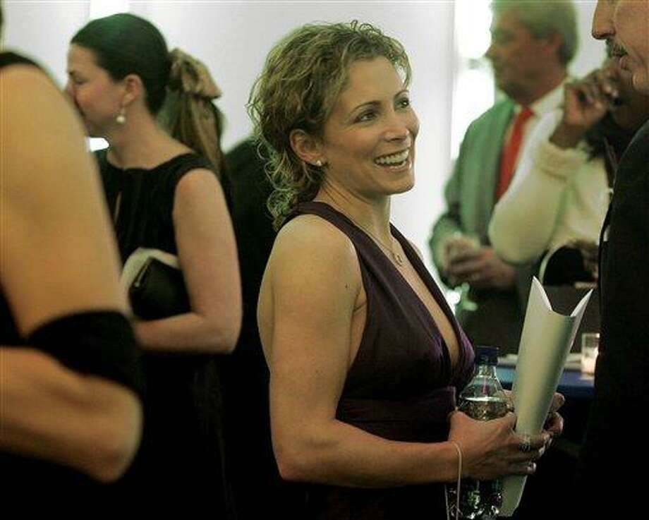 Olympic gymnast Shannon Miller smiles as she chats during a reception before being inducted in the U.S. Olympic Hall of Fame during a ceremony Thursday, Dec. 8, 2005, in Chicago. Miller won five medals at the 1992 games in Barcelona and two gold medals at the 1996 games in Atlanta. (AP Photo/Jeff Roberson) Photo: ASSOCIATED PRESS / AP2005