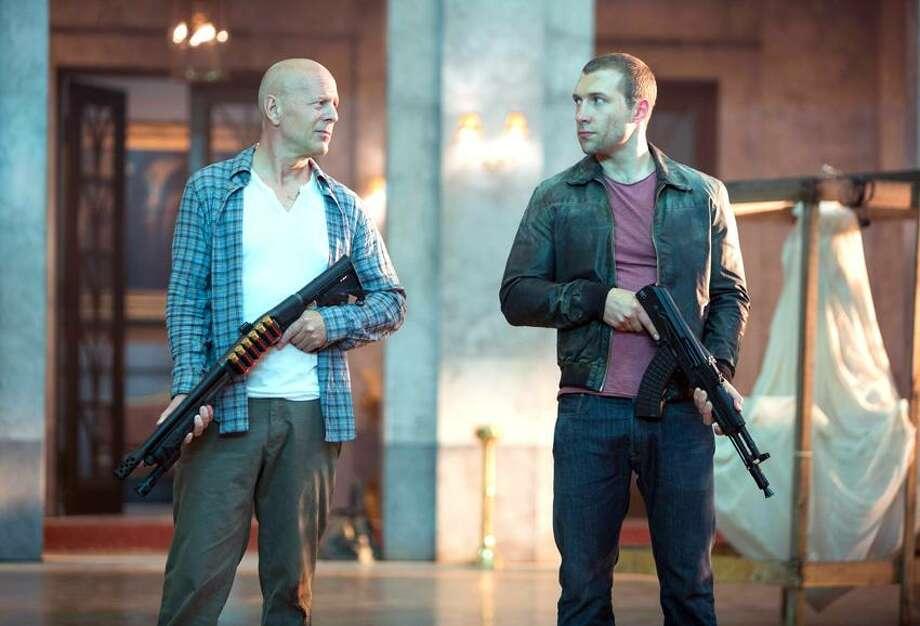 "Frank Masi/20th Century Fox photo: Bruce Willis, left, and Jai Courtney play gun-totin' father and son in ""A Good Day to Die Hard."" Photo: AP / Twentieth Century Fox Film Corporation2013"