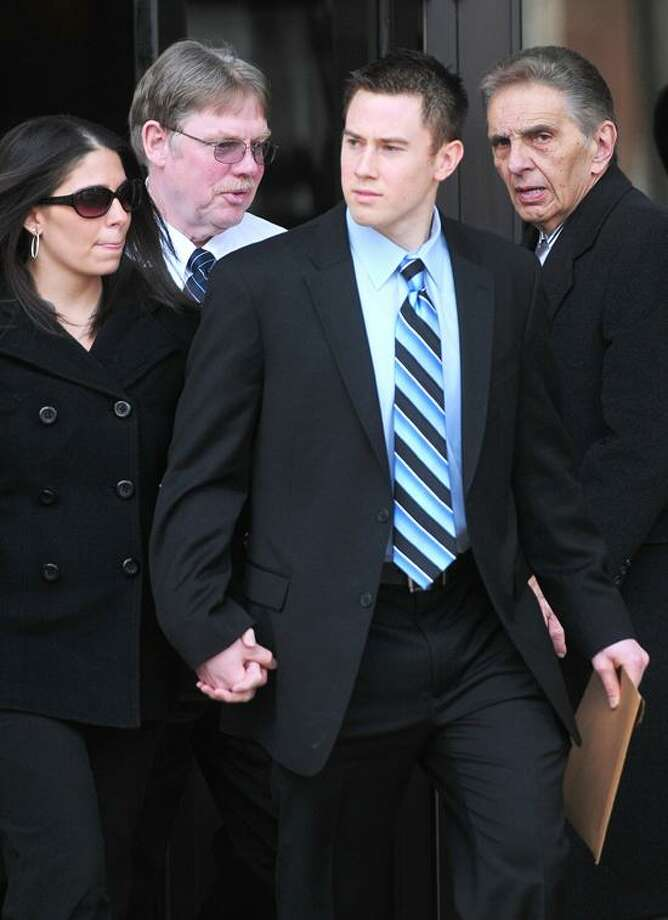 East Haven Police Officer Dennis Spaulding (second from right) walks out of U.S. District Court in Bridgeport after a bail hearing on 2/14/2012.Photo by Arnold Gold/New Haven Register  AG0439D