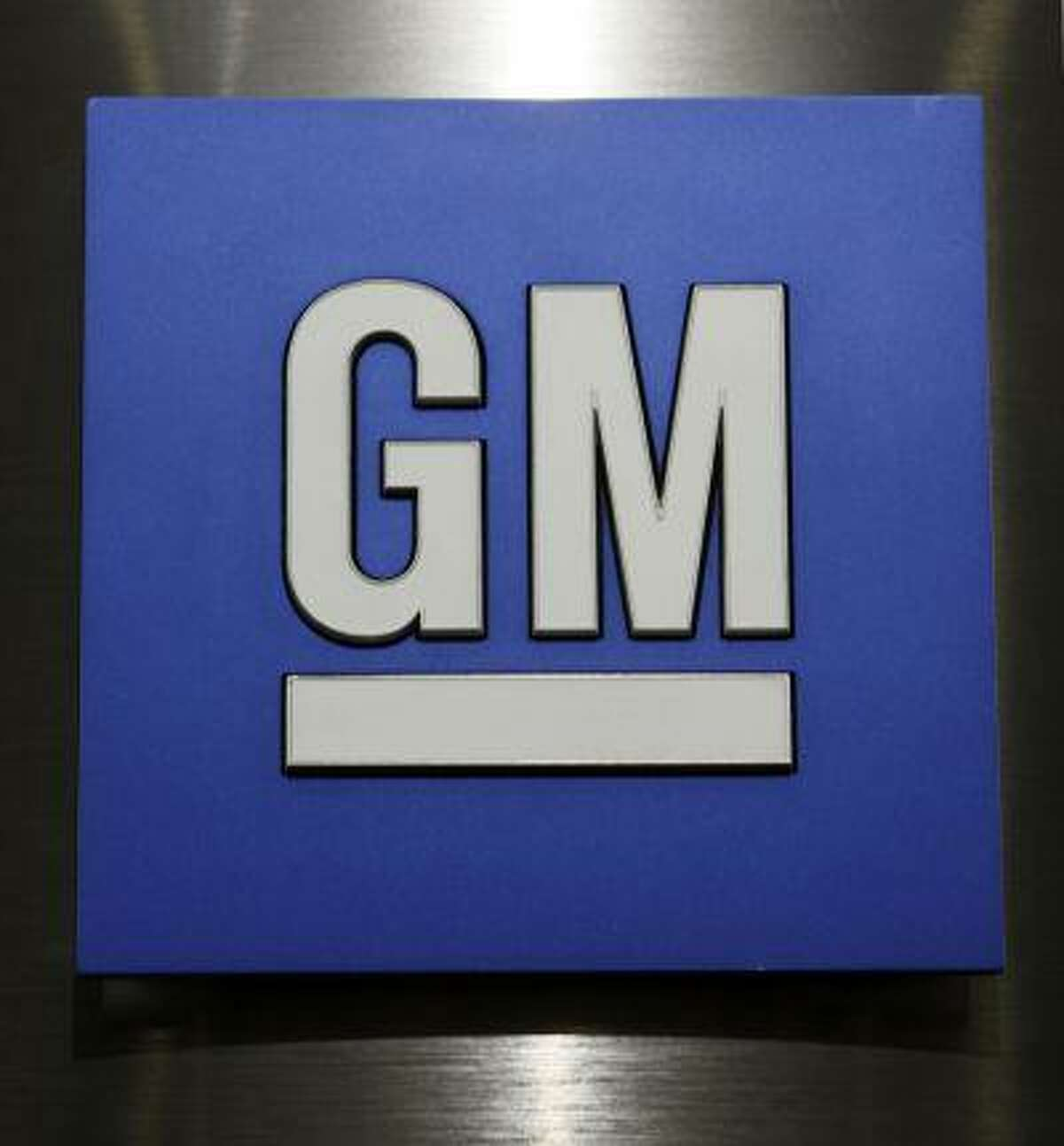 A General Motors logo is shown during a news conference in Detroit in 2010.