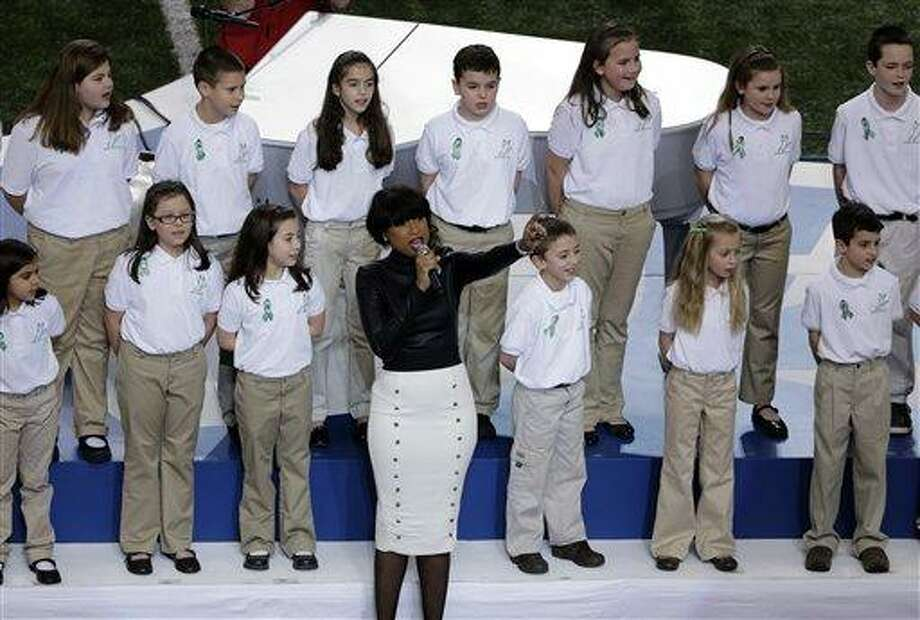 "Jennifer Hudson performs with students from Sandy Hook Elementary School singing ""America the Beautiful"" before the NFL Super Bowl XLVII football game between the San Francisco 49ers and the Baltimore Ravens, Sunday, Feb. 3, 2013, in New Orleans. (AP Photo/Gerald Herbert) Photo: AP / AP"