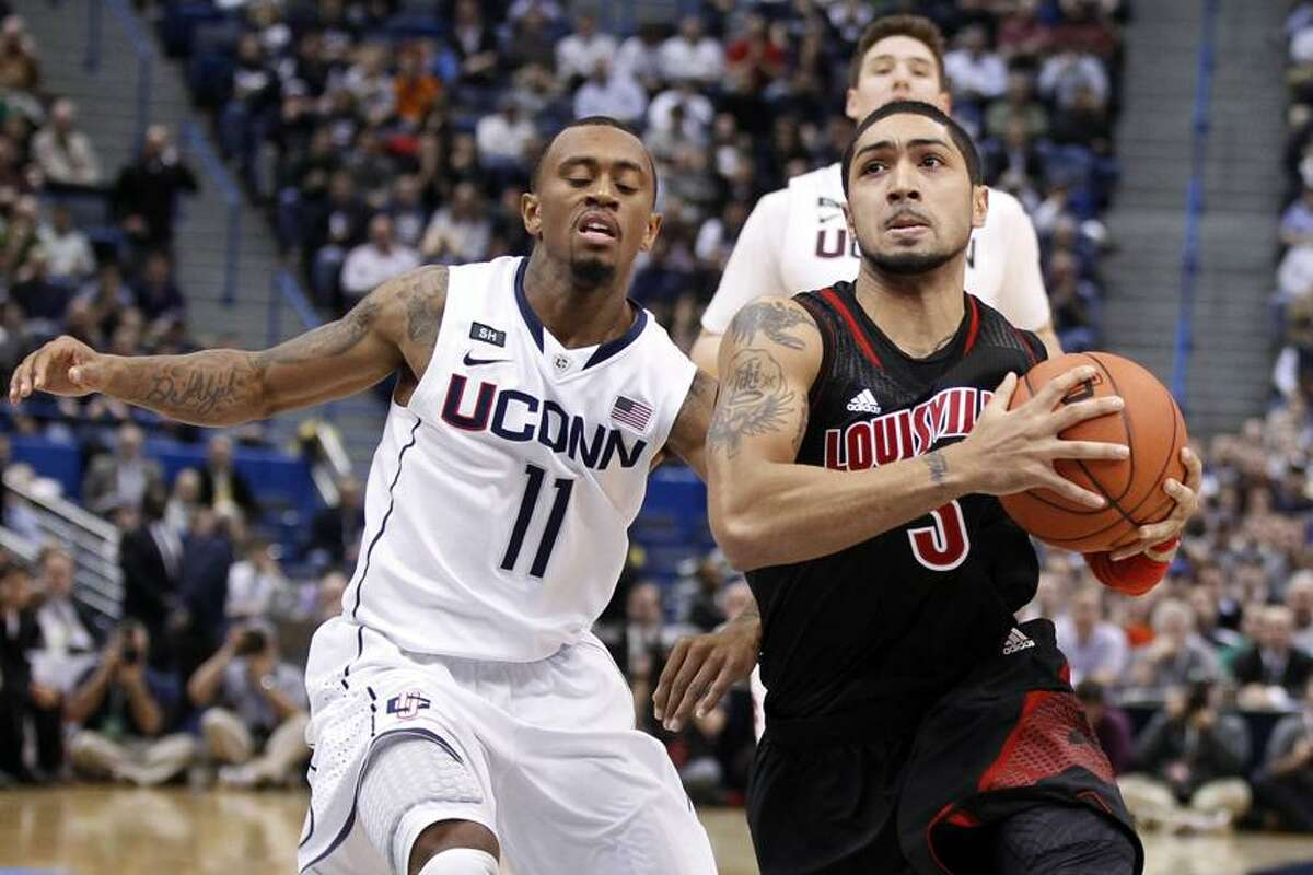 Jan 14, 2013; Hartford, CT, USA; Louisville Cardinals guard Peyton Siva (3) drives the ball to the basket against Connecticut Huskies guard Ryan Boatright (11) during the second half at the XL Center. The Louisville Cardinals defeated the Connecticut Huskies 73-58. (David Butler II-USA TODAY Sports)
