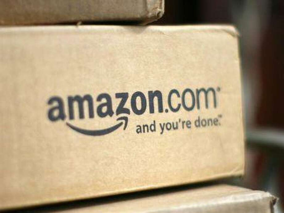 A box from Amazon.com is pictured on the porch of a house in Golden, Colorado July 23, 2008. Online retailer Amazon.com Inc said on Wednesday its quarterly profit doubled on a 41 percent rise in revenue, sending its shares up more than 6 percent. REUTERS/Rick Wilking / X00301