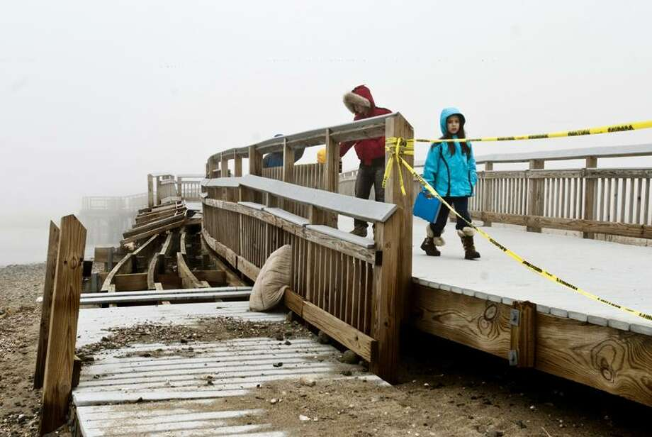 Milford-Damage from storm Sandy to the boardwalk at Silver Sands Park.   Melanie Stengel/Register
