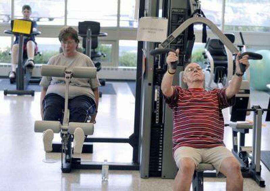 Rich Watton, right, Carol Roinson, center, and Janice Howell, back left, exercise in the gym at the Enfield Senior Center in Enfield, Conn., Aug. 13, 2008. Photo: ASSOCIATED PRESS / AP2008
