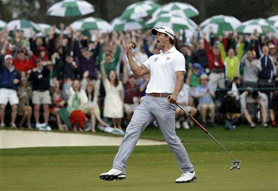 Adam Scott, of Australia, celebrates after a birdie putt on the 18th green during the fourth round of the Masters golf tournament Sunday, April 14, 2013, in Augusta, Ga. (AP Photo/David J. Phillip) Photo: AP / AP