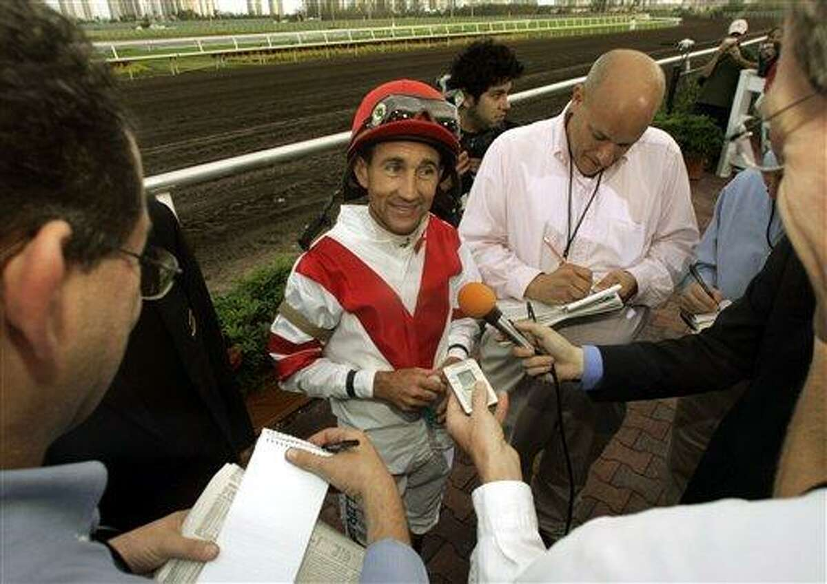 Jockey Jerry Bailey, center, talks to reporters after the last race of his career, Saturday, Jan. 28, 2006, at Gulfstream Park in Hallandale Beach, Fla. Bailey, 48, who came in second in the race, retired after racing Saturday in the Sunshine Millions. (AP PhotoWilfredo Lee)