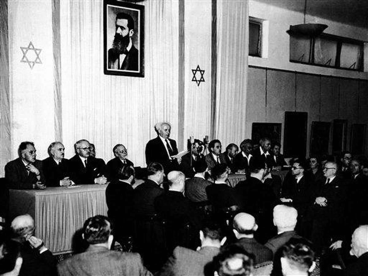 In this May 14, 1948 file photo, Cabinet Ministers of the new state of Israel are seen at a ceremony at the Tel Aviv Art Museum, marking the creation of the new state.during Premier and Defense Minister David Ben Gurion's speach. In 65 years, Israel has surpassed even the wildest dreams of its founding fathers. Against all odds, it has emerged as the Middle East's greatest military force, a global high-tech powerhouse and a prosperous, secure homeland for the Jewish people. (AP Photo, File)