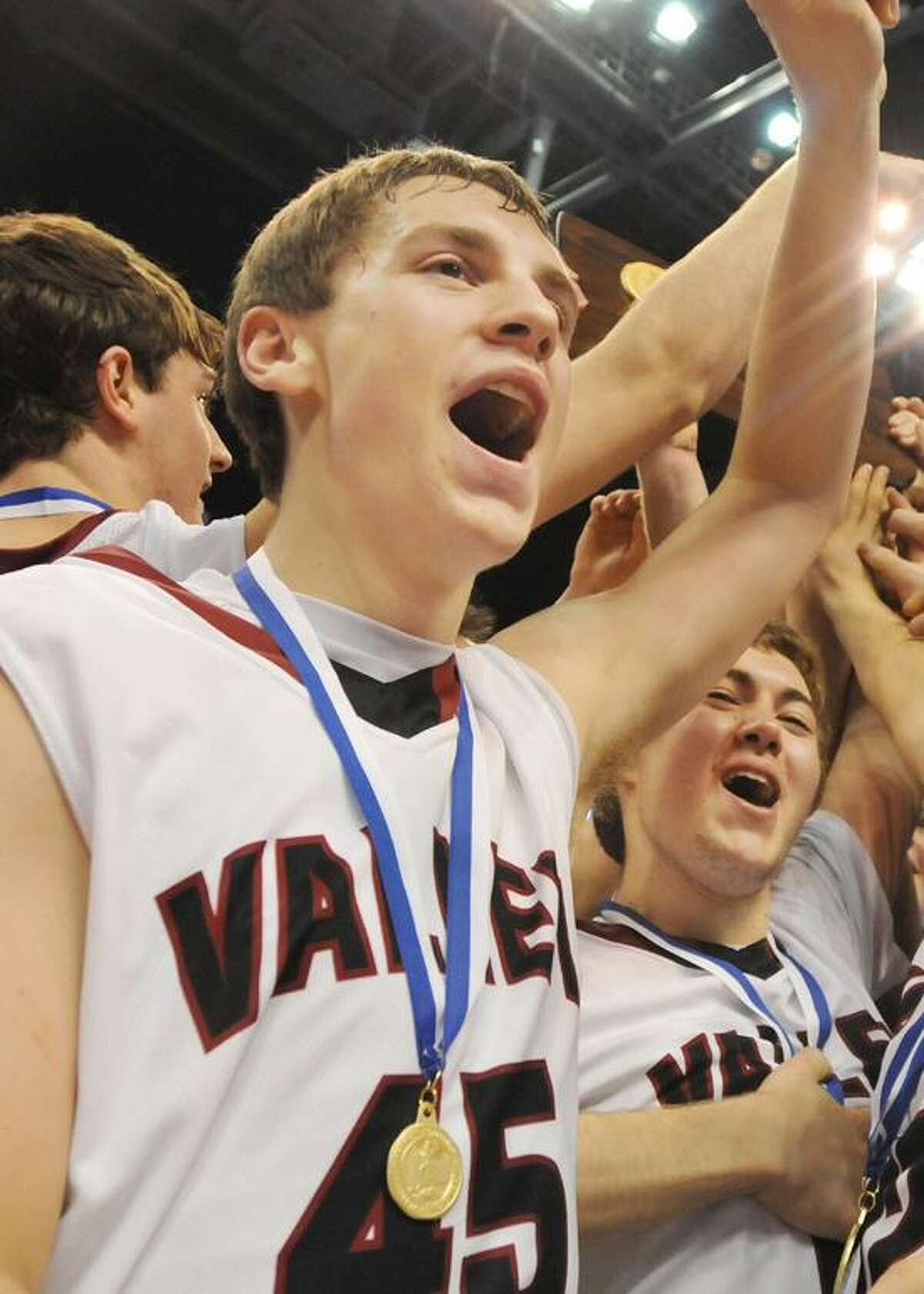 Valley Regional seniors Chris Polo (45) and Sean Cunningham (15) celebrate after clinching the Class M title on Friday. The Warriors defeated Weston 52-45 at the Mohegan Sun Arena. Catherine Avalone/The Middletown Press