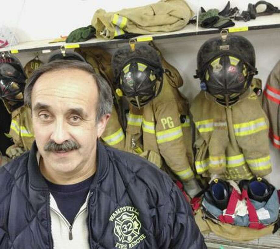 Jeff Cardinali, 55, has been fighting fires and volunteering in Wampsville for 16 years. Dispatch Staff Photo by JOHN HAEGER