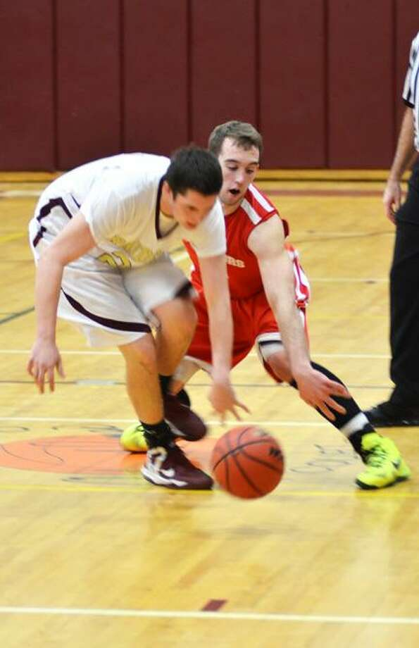 Dispatch Staff Photo by KYLE MENNIG Canastota's Zack Babcock, left, and Morrisville-Eaton's Will Thomas compete for a loose ball during their game Monday in Canastota. Thomas scored 35 points in M-E's 65-50 victory.