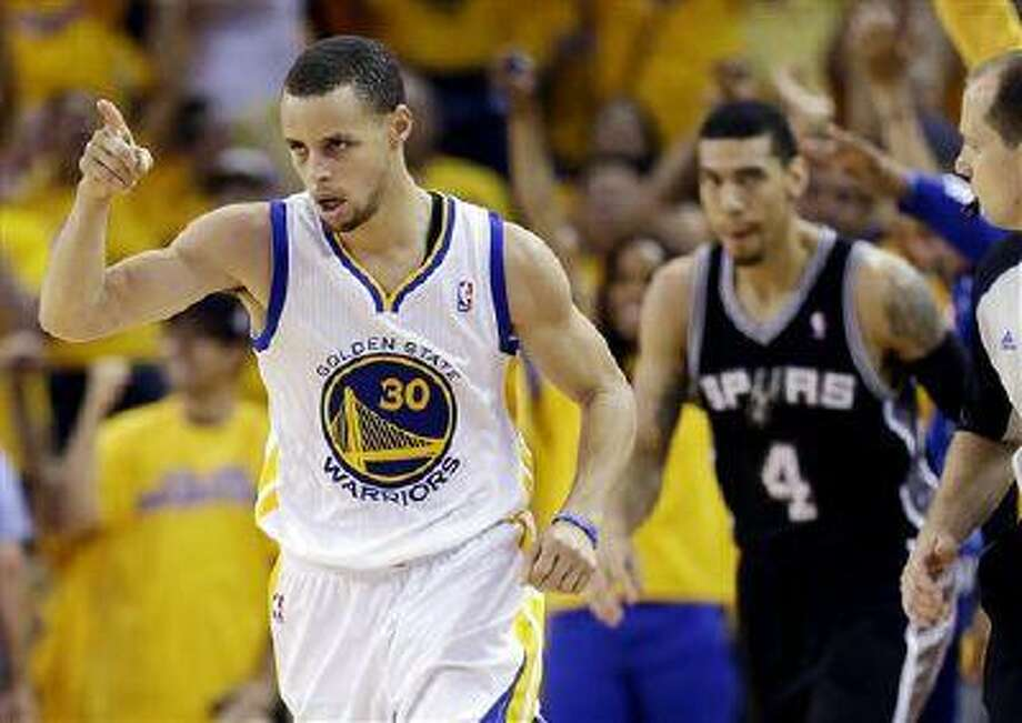 Golden State Warriors' Stephen Curry celebrates after scoring against the San Antonio Spurs' Danny Green (4) during the second half of Game 4 of a Western Conference semifinal in Oakland, Calif., May 12, 2013. Photo: AP / AP