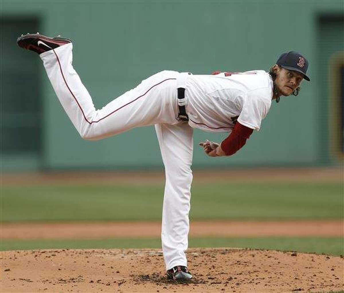 Boston Red Sox starting pitcher Clay Buchholz delivers against the Tampa Bay Rays during the first inning of a baseball game at Fenway Park in Boston Sunday, April 14, 2013. (AP Photo/Winslow Townson)