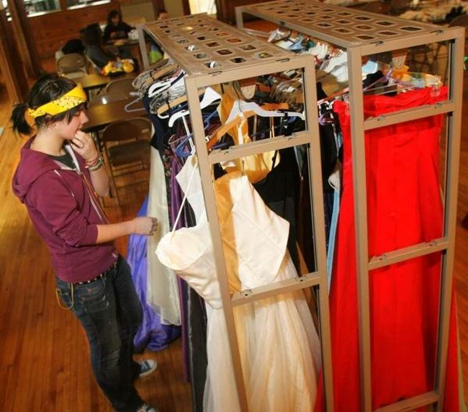 """Dispatch Staff Photo by JOHN HAEGER <a href=""""http://twitter.com/oneidaphoto"""">twitter.com/oneidaphoto</a> Abrina Leahey looks for dresses to try on during the annual   Prom and formal dress giveaway at First Presbyterian Church of Oneida on Saturday, march 31, 2012."""