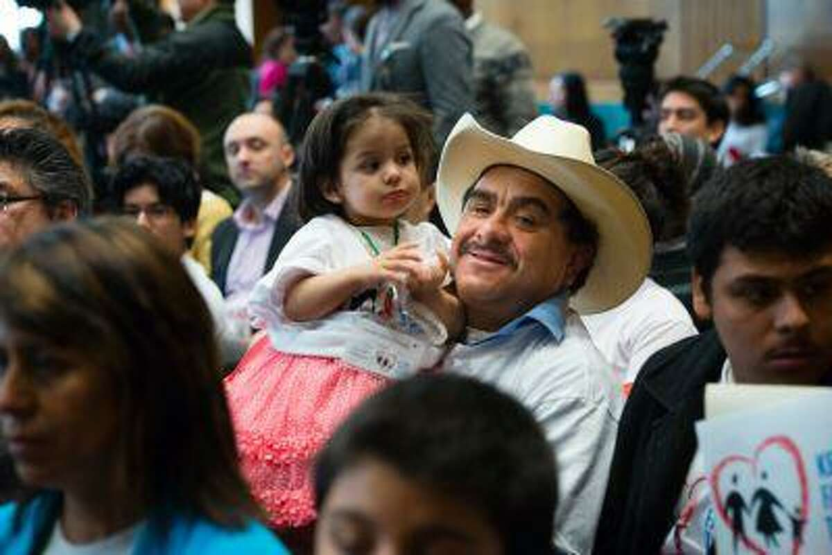 Rogelio Hidalgo, 48, a native of Mexico _ with daughter Lupita, 18 months _ lives in Redmond, Ore. He was among a group that came to Washington this week.(Washington Post photo by Sarah L. Voisin)
