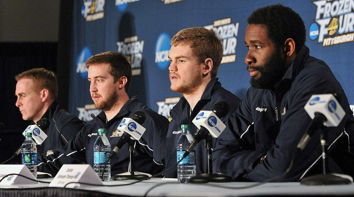 Pittsburg, PA-- Quinnipiac coach Rand Pecknold, Zach Currie, Jeremy Langlois and Jordan Samuels-Thomas during a press conference as they prepare to battle Yale for the National Championship. Photo-Peter Casolino/Register pcasolino@newhavenregister.com