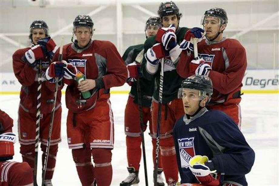 New York Rangers players, including Ryan Callahan, bottom right, listen during an informal NHL hockey workout, Wednesday, Jan. 9, 2013, in Greenburgh, NY.  (AP Photo/Seth Wenig) Photo: AP / AP