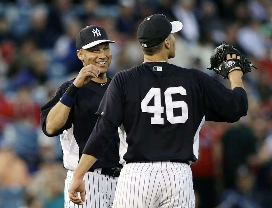 New York Yankees shortstop Derek Jeter (2) talks to Yankees starting pitcher Andy Pettitte (46) during a spring training baseball game against the Philadelphia Phillies in Tampa, Fla., Wednesday, March 13, 2013.  (AP Photo/Kathy Willens) Photo: AP / AP2013