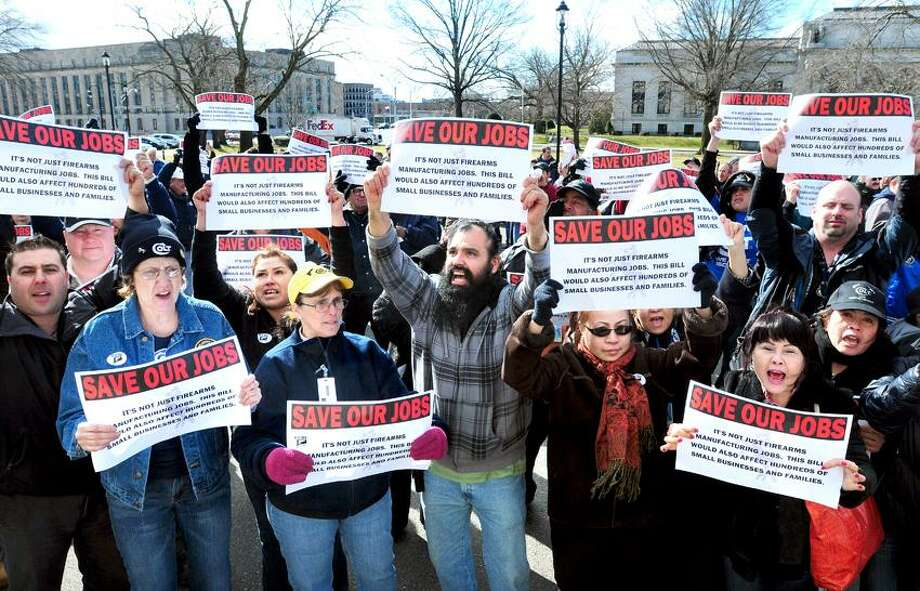 Workers from Colt's Manufacturing Company protest outside of the Capitol in Hartford on their way to buses after protesting at the Legislative Office Building on 3/14/2013.Photo by Arnold Gold/New Haven Register
