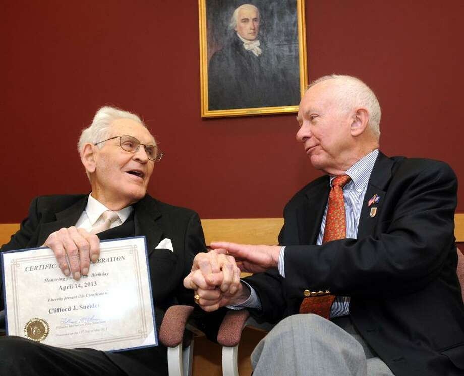 """Madison Town Offices: Clifford Sneider, Sr. of Madison, left, was honored by Madison First Selectman Fillmore McPherson after Sneider turned 104 last month. Mara Lavitt/New Haven Register <a href=""""mailto:mlavitt@newhavenregister.com"""">mlavitt@newhavenregister.com</a>5/13/13"""