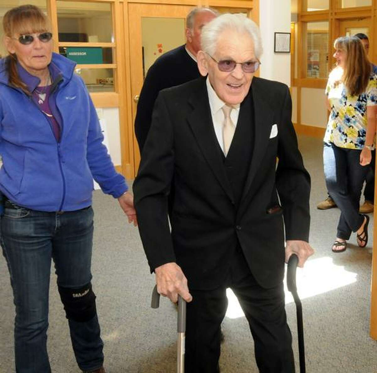 Madison Town Offices: Helen Sneider of Deep River, left, with her brother Clifford Sneider, Jr. mostly hidden, center, arrive with their father Clifford Sneider, Sr. of Madison, who was honored by Madison First Selectman Fillmore McPherson after Sneider turned 104 last month. Mara Lavitt/New Haven Register mlavitt@newhavenregister.com5/13/13