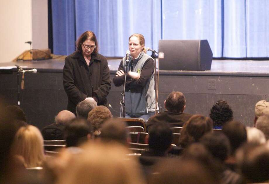 """Mothers of Sandy Hook Elementary School students speak during a community meeting at the Newtown High school on the future of Sandy Hook Elementary School  the site of the second-deadliest school shooting in U.S. <a href=""""http://history.in"""">history.in</a> Newtown, Connecticut January 14, 2013.  REUTERS/ Michelle McLoughlin/Pool Photo: REUTERS"""