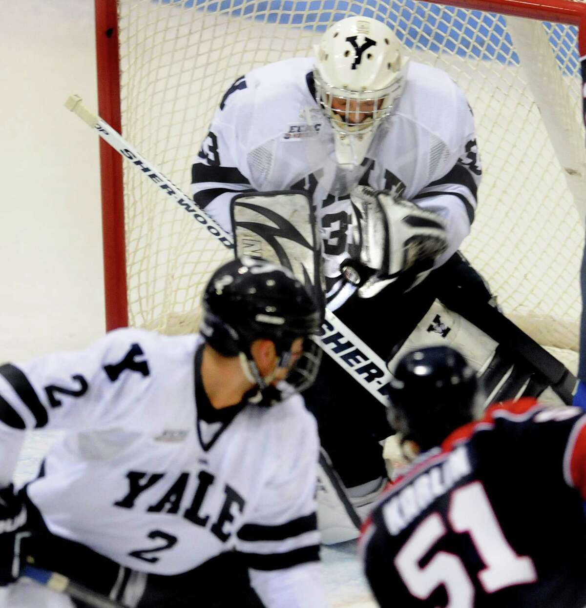 Sports__ Yale goalie Jeff Malcolm stops a shot in a game earlier in the year. Helping to cover is Yale's Gus Young. Melanie Stengel/Register