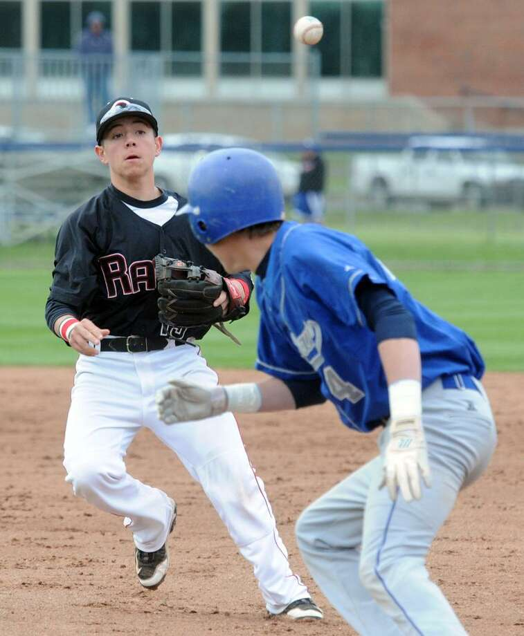 """Cheshire's Tommy Savino, left, West Haven's Mike Brand caught in a rundown between 2nd and 1st base. West Haven won 2-1 in 8 innings. Mara Lavitt/New Haven Register <a href=""""mailto:mlavitt@newhavenregister.com"""">mlavitt@newhavenregister.com</a>"""