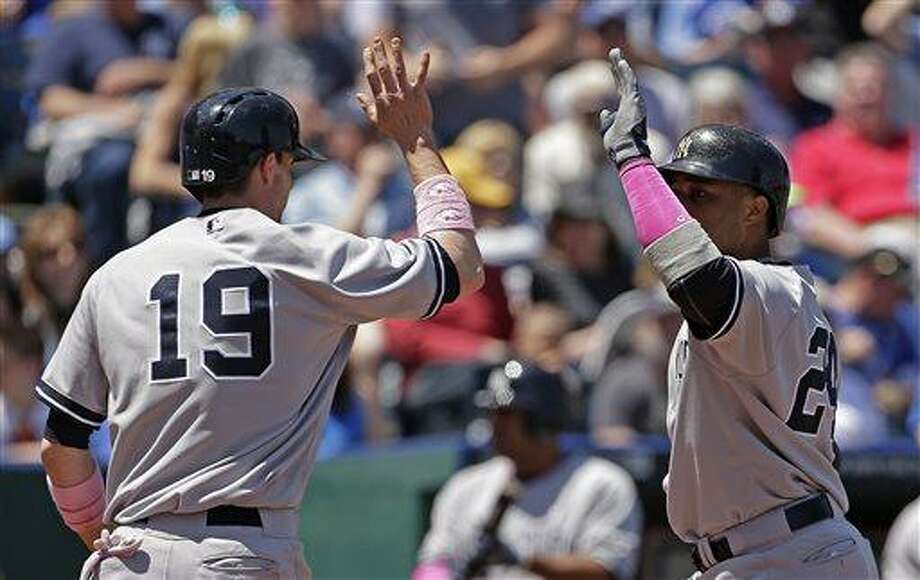 New York Yankees' Robinson Cano, right, celebrates with teammate Chris Stewart (19) after hitting a two-run home run during the third inning of a baseball game against the Kansas City Royals, Sunday, May 12, 2013, in Kansas City, Mo. (AP Photo/Charlie Riedel) Photo: AP / AP