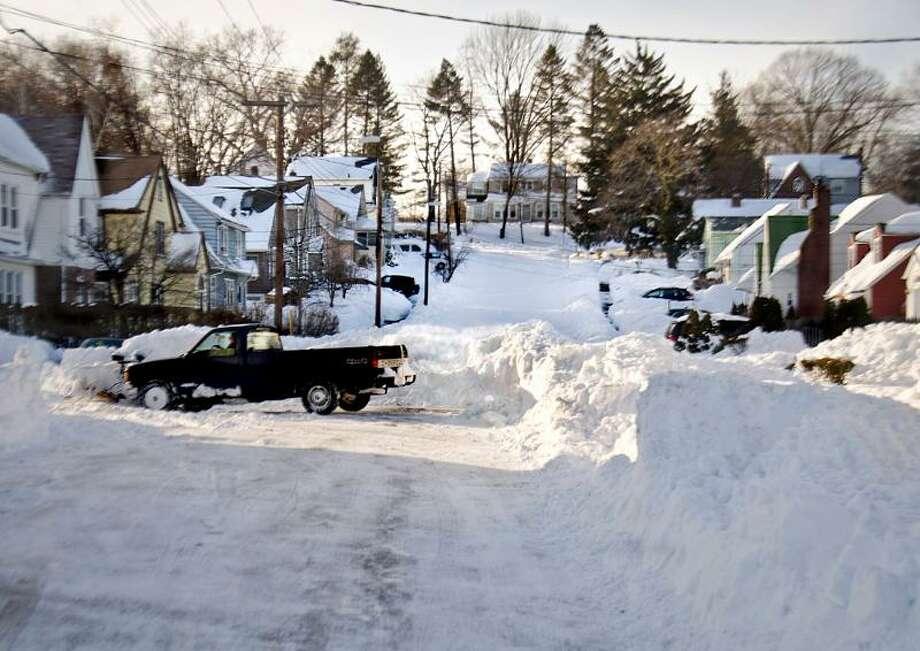 Hamden- Residents take things into their own hands and plow Gilbert street in Hamden. Melanie Stengel/Register