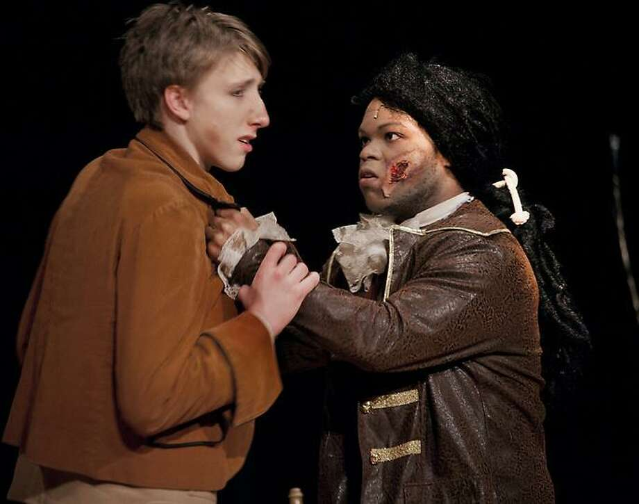 NOTRE DAME-Ian Spak (L) as Jim Hawkins, and Jamsal Hanley, as Billy Bones, in the opening scene from Treasure Island.  Melanie Stengel/Register