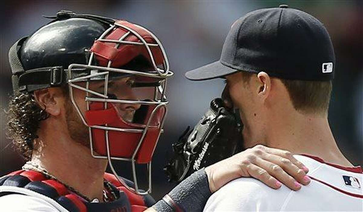 With his finger nails painted pink for Mother's Day, Boston Red Sox catcher Jarrod Saltalamacchia, left, talks with relief pitcher Clayton Mortensen during the sixth inning of a baseball game against the Toronto Blue Jays at Fenway Park in Boston, Sunday, May 12, 2013. (AP Photo/Winslow Townson)