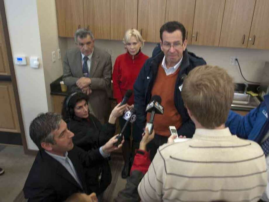 Governor Malloy addressing the press at the Branford Fire House on Main St in Branford at noontime February 11, 2013.vmwilliams