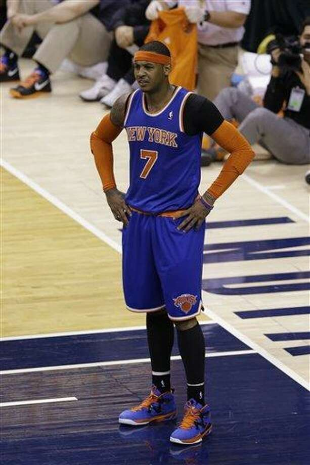 New York Knicks forward Carmelo Anthony questions a call during the second half against the Indiana Pacers in Game 3 of the Eastern Conference semifinal NBA basketball playoff series in Indianapolis, Saturday, May 11, 2013.  (AP Photo/Michael Conroy) Photo: AP / AP