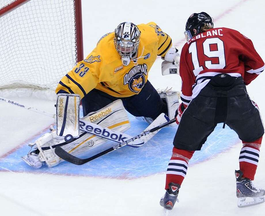 """Pittsburgh, PA--  Quinnipiac goalie Eric Hartzell makes the stop on the shot from St. Cloud's Drew LeBlanc in the first period.  Photo-Peter Casolino/Register  <a href=""""mailto:pcasolino@newhavenregister.com"""">pcasolino@newhavenregister.com</a>"""