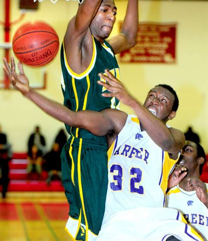 Paschal Chukwu, left, pictured here last year against Career, transferred to Fairfield Prep in the off-season, but Trinity Catholic is back in the top 10 once again without him. Photo by Arnold Gold/New Haven Register