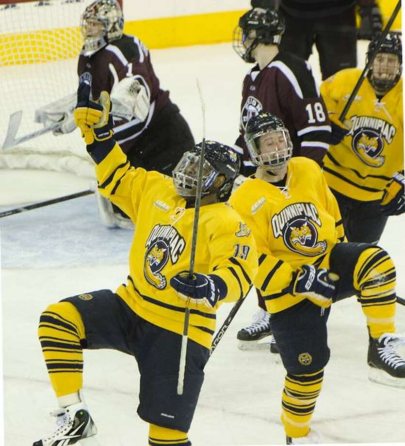 Sports-Quinnipiac's 	Jordan Samuels-Thomas (19) celebrates with teammates after scoring the tieing goal in the 3rd period of the game against Union. The Bobcats went on to win 3-2.   Melanoie Stengel/Register