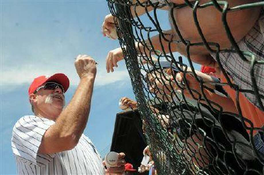 Former Yankees pitcher Goose Gossage signs autographs during the Hall of Fame Classics baseball game at Doubleday Field in Cooperstown, NY, June 19,2011. Photo: AP / FR49835 AP