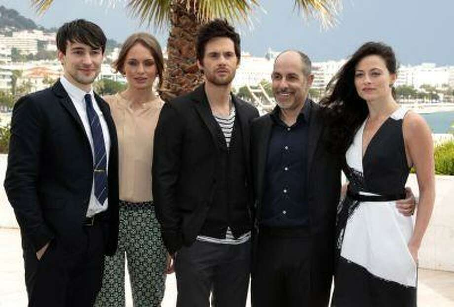 From L - R, actors Blake Ritson, Laura Haddock, Tom Riley, US screenwriter David S. Goyer and Lara Pulver attend a photocall for the television series 'Da Vinci's Demons' as part of the MIPTV, the International Television Programs Market, event in Cannes April 8, 2013. Photo: REUTERS / X00102