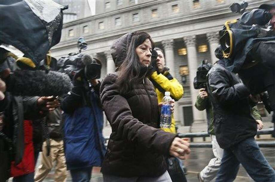 "Elizabeth Valle is surrounded by news reporters as she leaves court on Tuesday, March 12, 2013 in New York.   A federal jury convicted her son, New York City police officer Gilberto Valle, of charges he plotted to kidnap and cook women to dine on their ""girl meat.""   Valle, 28,  faces up to life in prison when he is sentenced on June 19. With the conviction, he loses his job as a police officer.  (AP Photo/Bebeto Matthews) Photo: AP / AP"
