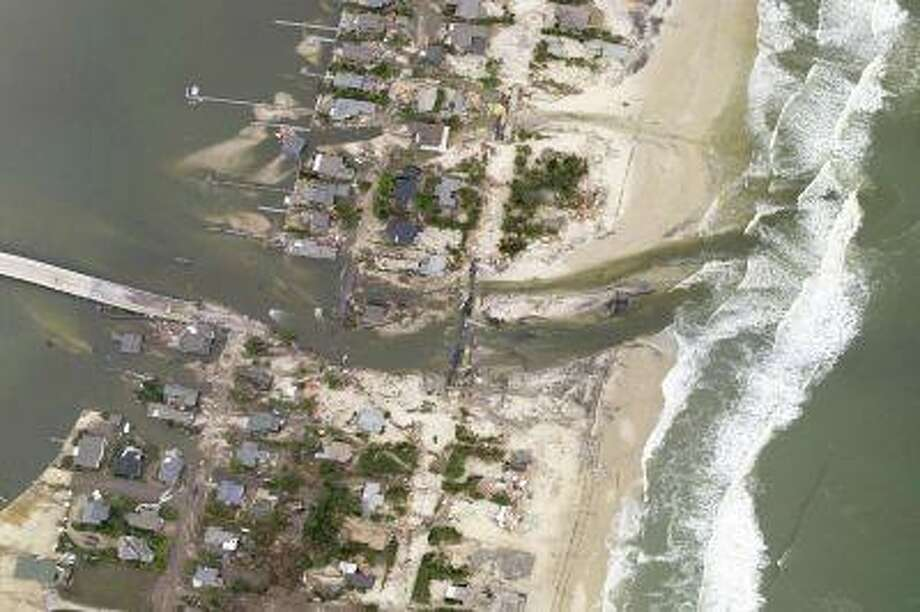 This National Oceanic and Atmospheric Administration (NOAA) photograph taken on Oct. 31, 2012, shows a new inlet that was cut across the barrier island of the New Jersey coastal town Mantoloking just north of where Hurricane Sandy made landfall in Ocean County, New Jersey. Photo: REUTERS / X80021
