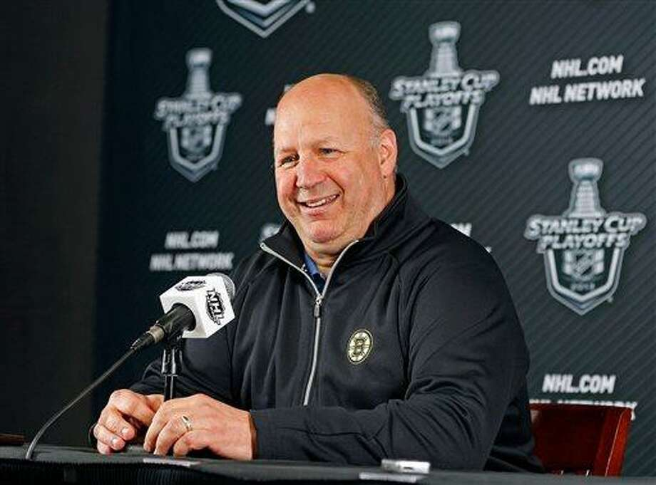 Boston Bruins head coach Claude Julien smiles during an NHL hockey news conference at the TD Garden, Thursday, May 9, 2013, in Boston. The Bruins lead the Toronto Maple Leafs 3-1 in their best-of-seven games first-round Stanley Cup playoff series. Game 5 is Friday in Boston. (AP Photo/The Boston Herald, Nancy Lane)  BOSTON GLOBE OUT; METRO BOSTON OUT; MAGS OUT; ONLINE OUT Photo: AP / The Boston Herald
