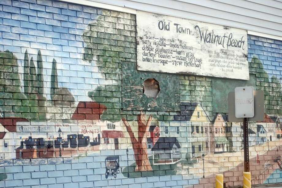 The mural on the side of what used to be Harrison's Hardware store shows Walnut Beach as it once was. Photo by Jen Fengler/for the Register