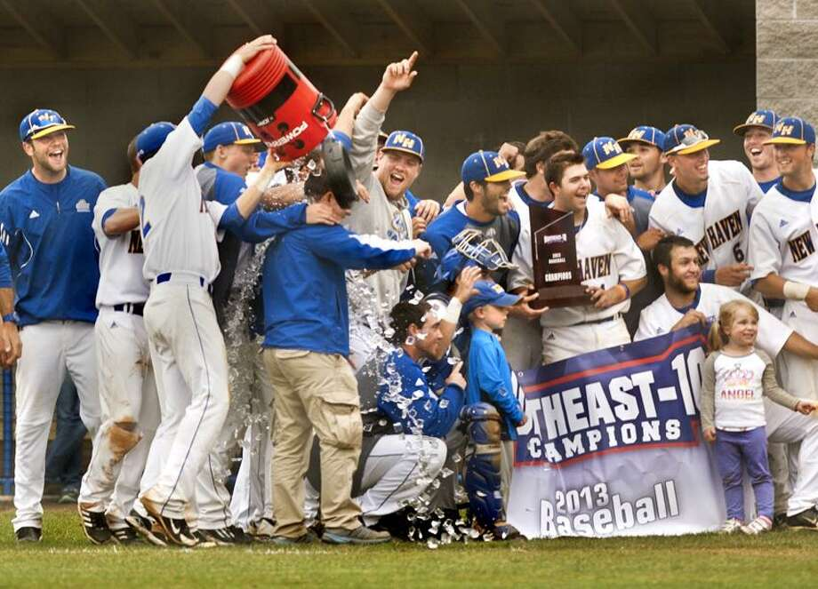 SPORTS-the University of New Haven baseball team celebrates winning the Northeast-10 Championship.   Melanie Stengel/Register