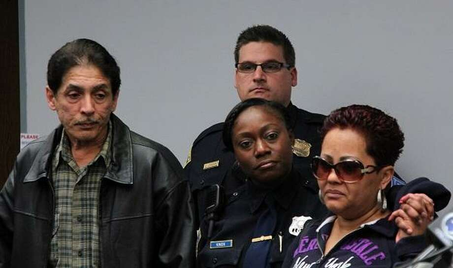 Fair Haven district manager Sgt. Herb Johnson and Officer Jillian Knox stand with Nerailda Morales and Asadrbal Bernier Sr., the parents of Asadrbal Bernier Jr., who was killed in a Fair Haven shooting on April 3. Photo by Rich Scinto.