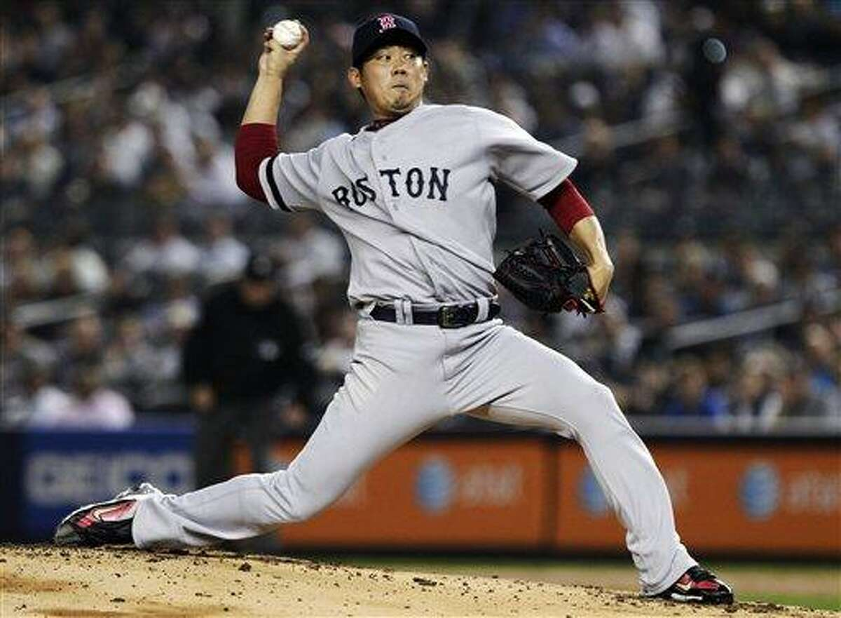 Boston Red Sox's Daisuke Matsuzaka, of Japan, delivers a pitch during the first inning of a baseball game against the New York Yankees, Wednesday, Oct. 3, 2012, in New York. (AP Photo/Frank Franklin II)